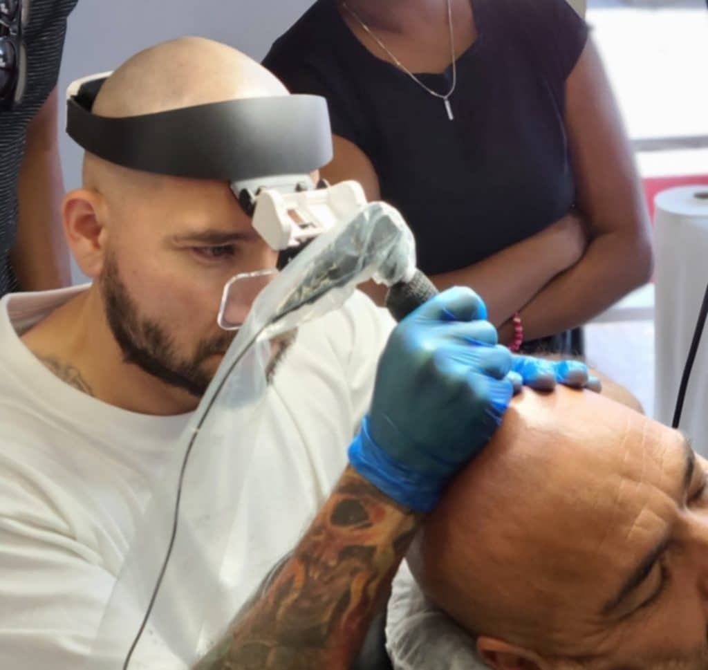 student performing scalp micropigmentation